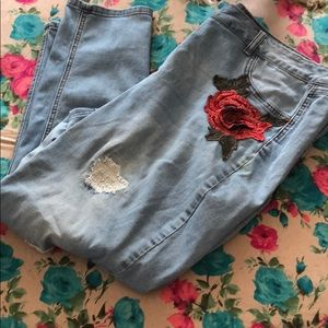 Blue designed ripped jeans